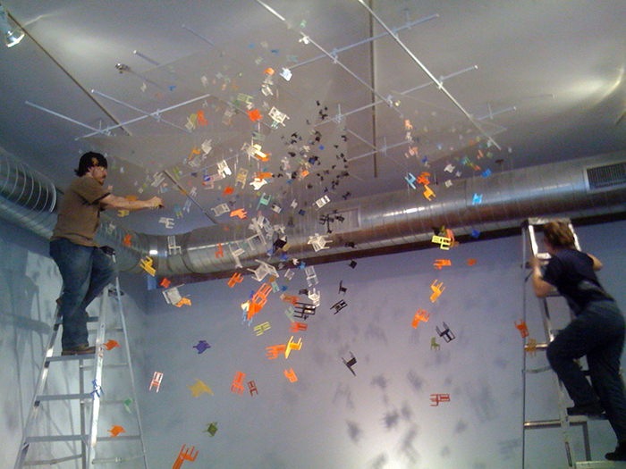 They Still Cast Shadows, 2010, cast resin, plexi and filament, installation in process Boston Sculptors Gallery