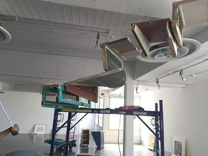 Up and Out, 2016, found objects and steel cable, installation in process at Artpace, San Antonio, Texas